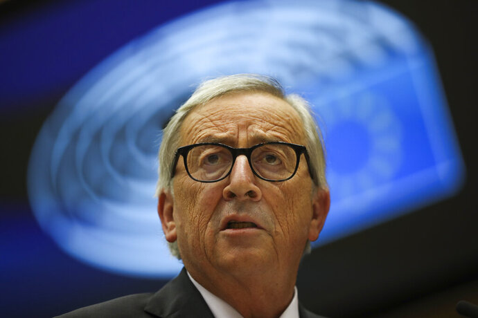 European Commission President Jean-Claude Juncker addresses European lawmakers at the European Parliament in Brussels, Wednesday, Oct. 9, 2019. (AP Photo/Francisco Seco)