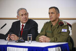 Israeli Prime Minister Benjamin Netanyahu, left, and IDF Chief of Staff Aviv Kochavi, hold press conference following the killing of a senior Islamic Jihad commander in Gaza by Israel, in Tel Aviv, Israel, Tuesday, Nov. 12, 2019. (AP Photo/Oded Balilty)