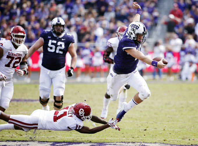 Oklahoma cornerback Parnell Motley (11) tackles TCU quarterback Michael Collins (10) during the second half of an NCAA college football game, Saturday, Oct. 20, 2018, in Fort Worth, Texas. Oklahoma won 52-27. (AP Photo/Brandon Wade)