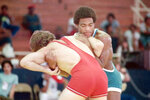In this image provided by the U.S. Olympic and Paralympic Committee (USOPC), United States wrestler Lee Kemp, right, competes in the 1979 Pan American Games in San Juan, Puerto Rico. The U.S. boycott of the Moscow Olympics crushed Kemp's dreams, along with all the predictions that he would win a gold medal. (Walter Meives/USOPC via AP)