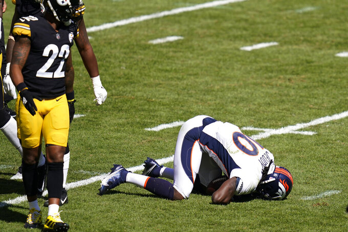 Denver Broncos wide receiver Jerry Jeudy (10) is hurt on the field during the first half of an NFL football game against the Pittsburgh Steelers, Sunday, Sept. 20, 2020, in Pittsburgh. (AP Photo/Keith Srakocic)