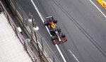 Red Bull driver Sergio Perez of Mexico steers his car during the Formula One Grand Prix at the Baku Formula One city circuit in Baku, Azerbaijan, Sunday, June 6, 2021. (AP Photo/Darko Vojinovic)