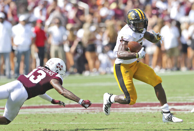 Southern Mississippi wide receiver Tim Jones (5) scrambles away from Mississippi State cornerback Tyler Williams (13) in the first half of an NCAA college football game Saturday, Sept. 7, 2019, in Starkville, Miss. (AP Photo/Jim Lytle)