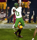 Cornerback Deommodore Lenoir #0 of the Oregon Ducks intercepts a pass intended for wide receiver Tyler Vaughns #21 of the USC Trojans in the first half of a NCAA football game at the Los Angeles Memorial Coliseum in Los Angeles on Friday, December 18, 2020. (Photo by Keith Birmingham, Pasadena Star-News/ SCNG)/The Orange County Register via AP)