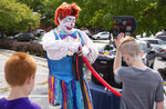 In this Saturday, Sept. 7, 2019 photo, Happy D. Klown makes balloon hats during Applefest at Christ United Methodist in Lincoln, Neb. (Emily Janey/Lincoln Journal Star via AP)