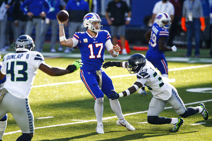 Buffalo Bills' Josh Allen (17) throws a pass over Seattle Seahawks' Jamal Adams (33) for a touchdown during the first half of an NFL football game Sunday, Nov. 8, 2020, in Orchard Park, N.Y. (AP Photo/John Munson)