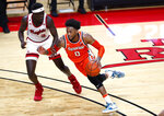 Syracuse forward Alan Griffin (0) drives to the basket against Rutgers forward Mawot Mag (3) during the first half of an NCAA college basketball game in Piscataway, N.J., Tuesday, Dec. 8, 2020. (AP Photo/Noah K. Murray)