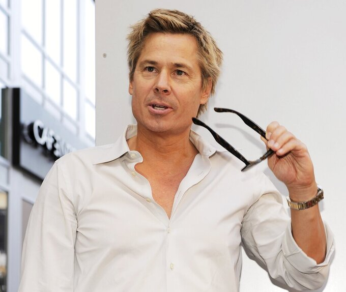 "FILE - In this Sept. 14, 2010, file photo, Brian ""Kato"" Kaelin poses for photographers following a ceremony awarding comedian Bill Maher with a star on the Hollywood Walk of Fame in Los Angeles. Kaelin, a struggling actor living in a guest house on Simpson's property, testified he heard a bump during the night of the murders and went outside to find Simpson in the yard, something prosecutors say showed Simpson was sneaking back home after the killings. (AP Photo/Chris Pizzello, File)"