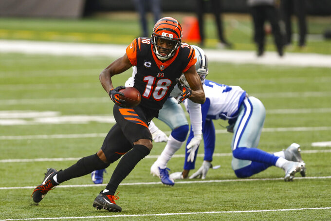 Cincinnati Bengals wide receiver A.J. Green (18) runs after a catch against the Dallas Cowboys in the first half of an NFL football game in Cincinnati, Sunday, Dec. 13, 2020. (AP Photo/Aaron Doster)