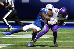 Minnesota Vikings' Alexander Mattison (25) is tackled by Indianapolis Colts' Darius Leonard (53) during the first half of an NFL football game, Sunday, Sept. 20, 2020, in Indianapolis. (AP Photo/AJ Mast)