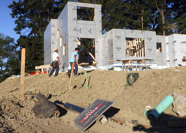 A new home is under construction on Wednesday, Aug. 19, 2020, in Pine Township, Pa.  U.S. construction spending edged up a tiny 0.1% in July, breaking a string of losses due to disruptions caused by the coronavirus pandemic. (AP Photo/Ted Shaffrey)
