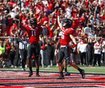 Texas Tech's Dalton Rigdon (86) celebrates after scoring a touchdown during the second half of an NCAA college football game against Oklahoma State, Saturday, Oct. 5, 2019, in Lubbock, Texas. (AP Photo/Brad Tollefson)