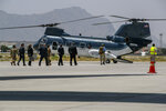 Secretary of State Mike Pompeo, third from right in suit, walks to board a helicopter upon arrival in Kabul, Afghanistan, Tuesday, June 25, 2019, during an unannounced stop. (AP Photo/Jacquelyn Martin, Pool)