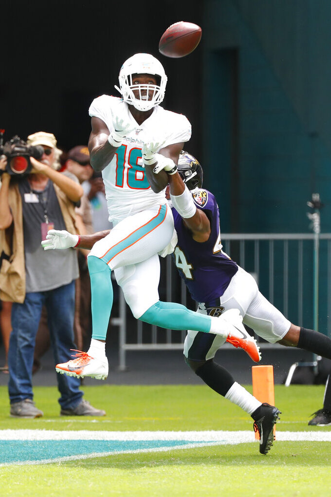 Miami Dolphins wide receiver Preston Williams (18) eyes a pass as Baltimore Ravens cornerback Marlon Humphrey (44) defends, during the first half at an NFL football game, Sunday, Sept. 8, 2019, in Miami Gardens, Fla. (AP Photo/Wilfredo Lee)