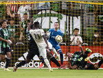 Los Angeles FC midfielder Jose Cifuentes (11) attempts a shot on goal against Austin FC defender Jhohan Romaña (3) and goalkeeper Brad Stuver during the first half of an MLS soccer match, Wednesday, Sept. 15, 2021, in Austin, Texas. The shot was wide. (AP Photo/Michael Thomas)