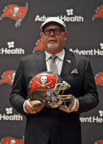 New Tampa Bay Buccaneers head coach Bruce Arians holds a helmet as he is introduced during a news conference Thursday, Jan. 10, 2019, in Tampa, Fla. (AP Photo/Chris O'Meara)