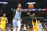 Memphis Grizzlies' Ja Morant (12) goes up for a shot as Utah Jazz's Emmanuel Mudiay (8) defends during the first half of an NBA basketball game Friday, Nov. 15, 2019, in Memphis, Tenn. (AP Photo/Karen Pulfer Focht)