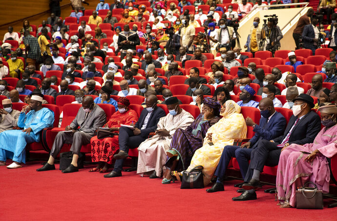 Delegates attend a conference to discuss a transition to a civilian government in Bamako, Mali, Thursday, Sept. 10, 2020. Leaders of Mali's military junta who deposed the West African country's president last month are meeting with political parties and civil society groups to outline a transition to a civilian government and, ultimately, elections. (AP Photo)