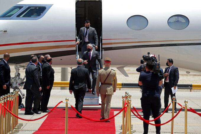Jordan's King Abdullah II, center, arrives in Baghdad, Iraq, Sunday, June 27, 2021. (AP Photo/Khalid Mohammed)