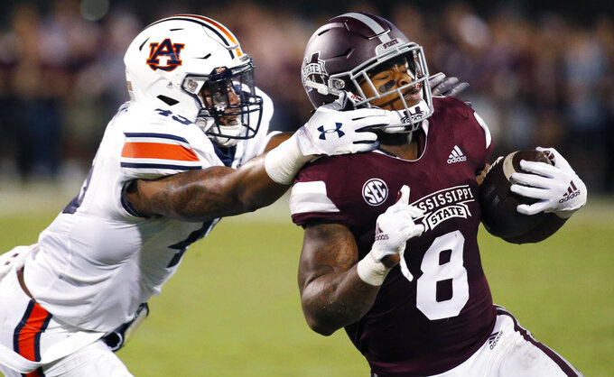 Mississippi State running back Kylin Hill (8) breaks away from a attempted tackle by Auburn linebacker Darrell Williams (49) as he runs for a first down during the first half of their NCAA college football game in Starkville, Miss., Saturday, Oct. 6 2018. (AP Photo/Rogelio V. Solis)