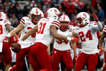 Nebraska linebacker Collin Miller (31) celebrates with teammates after recovering a fumble from Maryland running back Javon Leake (20) during a kick-return in the first half of an NCAA college football game, Saturday, Nov. 23, 2019, in College Park, Md. (AP Photo/Will Newton)