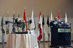 Lebanese Defense Minister Elias Bou Saab speaks next to part of an Israeli drone that crashed in southern Beirut last month during a press conference to announce the results of an investigation into the incident, at the Lebanese Defense Ministry, in Yarzeh near Beirut, Lebanon, Thursday, Sept. 19, 2019. The investigation has concluded that two Israeli drones that crashed in the Lebanese capital last month were on an attack mission, one of them armed with 4.5 kilograms of explosives. (AP Photo/Bilal Hussein)
