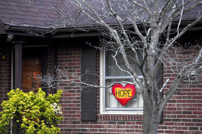 A home is East Asheville displays a heart with the word