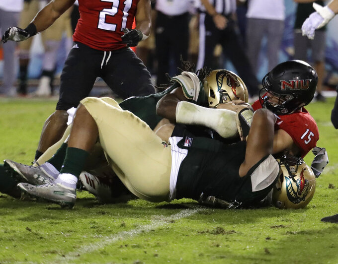 Northern Illinois quarterback Marcus Childers (15) is sacked by UAB defensive lineman Zachary Williams, bottom, during the second half of the Boca Raton Bowl NCAA college football game, Tuesday, Dec. 18, 2018, in Boca Raton, Fla. UAB won 37-13. (AP Photo/Lynne Sladky)