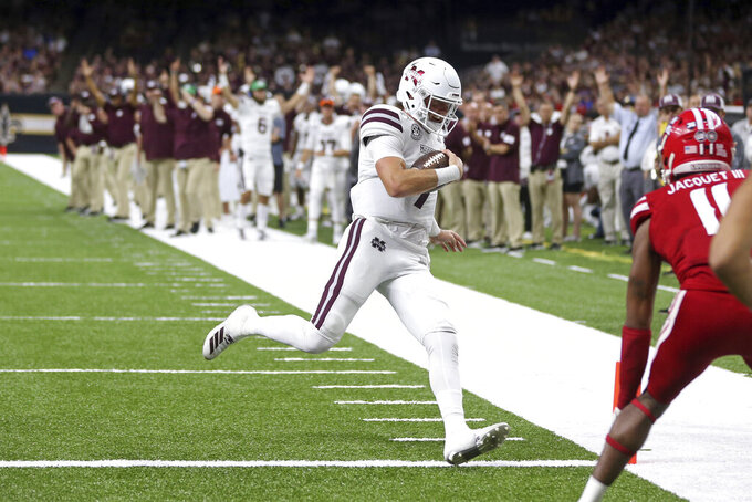 Mississippi State quarterback Tommy Stevens (7) scores a touchdown on a four-yard run in the second quarter of an NCAA college football game against the Louisiana-Lafayette in New Orleans, Saturday, Aug. 31, 2019. (AP Photo/Chuck Cook)