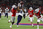 Utah State wide receiver Jordan Nathan catches the ball over his shoulder to set up a touchdown, as Fresno State defensive backs Chris Gaston, left, Evan Williams, middle, and Jaron Bryant, right, try to defend during the first half of an NCAA college football game in Fresno, Calif., Saturday, Nov. 9, 2019. (AP Photo/Gary Kazanjian)