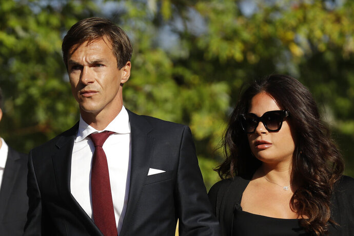 Danish golfer and Ryder Cup winner Thorbjorn Olesen, left, arrives at Isleworth Crown Court in London, Wednesday, Sept. 18, 2019, after being charged with sexual assault, being drunk on an aircraft and common assault. Olesen was arrested on 29 July after returning from the WGC St Jude Invitational on a flight from Nashville to London. Police were waiting for the 29-year-old when the aircraft landed at Heathrow. (AP Photo/Matt Dunham)