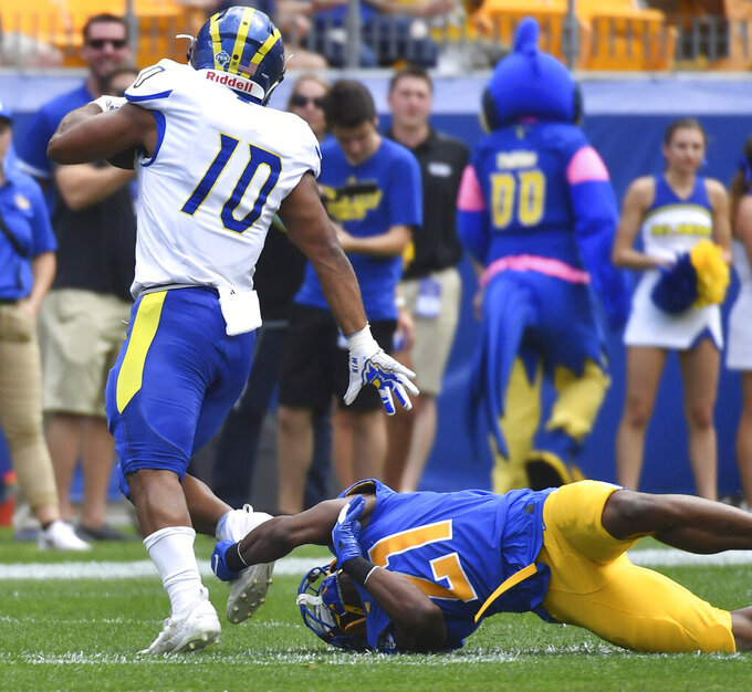Pitt defensive back Damarri Mathis reaches to take down Delaware running back Andre Robinson in the first quarter of an NCAA college football game Saturday, Sept. 28 2019, at Heinz Field in Pittsburgh. (Matt Freed/Pittsburgh Post-Gazette via AP)