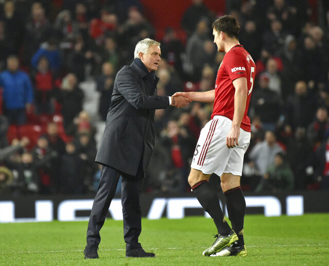 Tottenham's manager Jose Mourinho shakes hands with Manchester United's Harry Maguire the English Premier League soccer match between Manchester United and Tottenham Hotspur at Old Trafford in Manchester, England, Wednesday, Dec. 4, 2019. (AP Photo/Rui Vieira)