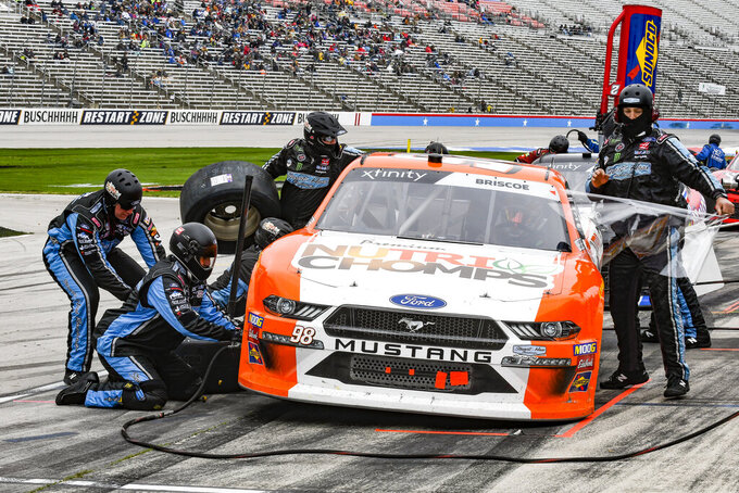 Chase Briscoe's pit crew services his car during a NASCAR auto race at Texas Motor Speedway, Saturday, March 30, 2019, in Fort Worth, Texas. (AP Photo/Randy Holt)