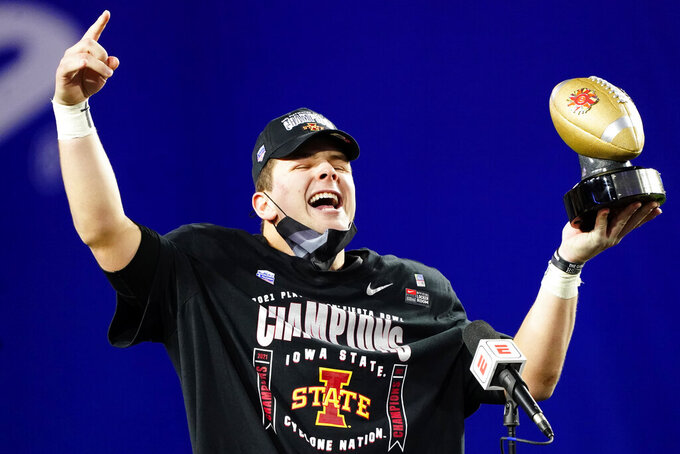 Iowa State quarterback Brock Purdy holds the offensive player of the game award after the Fiesta Bowl NCAA college football game against Oregon, Saturday, Jan. 2, 2021, in Glendale, Ariz. Iowa State won 34-17. (AP Photo/Rick Scuteri)