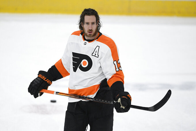 """FILE - Philadelphia Flyers center Kevin Hayes (13) warms up before an NHL hockey game against the Washington Capitals in Washington, in this Tuesday, April 13, 2021, file photo. Flyers center Kevin Hayes had abdominal surgery Tuesday, Sept. 21, 2021, and is expected to miss six to eight weeks. Flyers coach Alain Vigneault said Hayes skated with his teammates at the team complex in Voorhees, New Jersey when he """"felt something in his groin."""" He had surgery and could miss roughly the first 10 games of the season.  (AP Photo/Nick Wass, File)"""