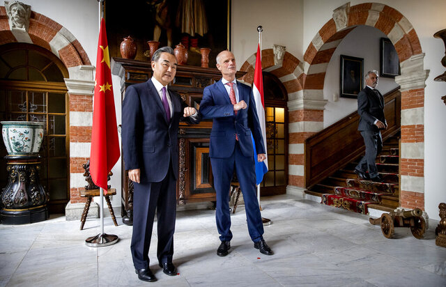 Dutch Foreign Minister Stef Blok, right, greets his Chinese counterpart Wang Yi, left, at Duivenvoorde Castle in Voorschoten, The Netherlands, on Wednesday Aug. 26, 2020.  China's minister is making a regional tour along different countries to encourage more cooperation between China and Europe.(Koen van Weel/ANP via AP)
