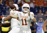 Texas quarterback Sam Ehlinger (11) throws a pass against Rice during the first half of an NCAA college football game Saturday, Sept. 14, 2019, in Houston. (AP Photo/Eric Gay)