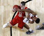 Texas Tech's Matt Mooney (13) and Virginia's Braxton Key battle for a rebound during the second half in the championship of the Final Four NCAA college basketball tournament, Monday, April 8, 2019, in Minneapolis. (AP Photo/David J. Phillip)