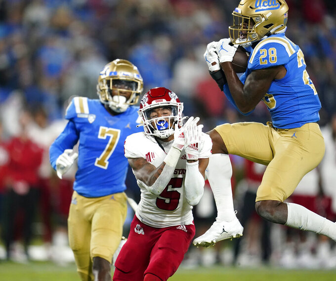 UCLA defensive back Evan Thomas (28) intercepts a pass intended for Fresno State wide receiver Jalen Cropper (5) during the first half of an NCAA college football game Saturday, Sept. 18, 2021, in Pasadena, Calif. (AP Photo/Marcio Jose Sanchez)
