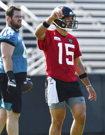 Jacksonville Jaguars quarterback Gardner Minshew II gives directions during drills at NFL football training camp, Wednesday, July 28, 2021, at the team's practice fields outside TIAA Bank Field in Jacksonville, Fla. (Bob Self/The Florida Times-Union via AP)