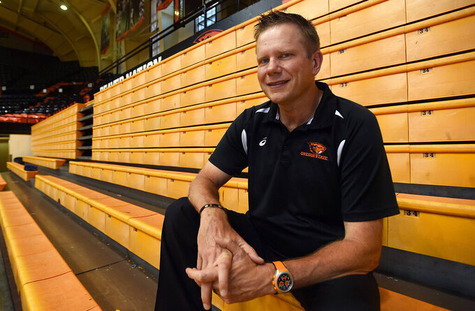 In this undated file photo, Oregon State University volleyball coach Mark Barnard poses for a photo in Corvallis, Ore. Oregon State leaders are suing to block disclosure of details about an investigation of abuse allegations in their volleyball program, even as they tout a refreshed mission for transparency in wake of their president's resignation over the handling of sexual-misconduct cases at another school. Meanwhile, the school is pressing forward with a lawsuit to prevent disclosing details about an internal investigation of the volleyball program and its current coach, Mark Barnard, who critics say has been running an emotionally exploitative program.( Godofredo Vasquet/Albany Democrat-Herald via AP, File)