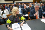 Rep. Carolyn Maloney, D-N.Y., left, and Rep. Peter King, R-N.Y., testify at a hearing by the House Judiciary Committee as it considers permanent authorization of the Victim Compensation Fund for firefighters, first responders and survivors of the September 11 terror attacks, on Capitol Hill in Washington, Tuesday, June 11, 2019. (AP Photo/J. Scott Applewhite)
