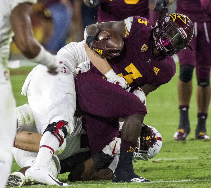 Arizona State's Eno Benjamin gets tackled by Stanford's Michael Williams during the first half of an NCAA college football game Thursday, Oct. 18, 2018, in Tempe, Ariz. (AP Photo/Darryl Webb)