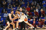 DePaul forward Jaylen Butz (2) is defended by Northwestern center Ryan Young (15) during the first half of an NCAA college basketball game, Saturday, Dec. 21, 2019, in Chicago. (AP Photo/David Banks)