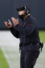 Atlanta Falcons head coach Dan Quinn encourages his team during the second half of an NFL football game against the Green Bay Packers, Monday, Oct. 5, 2020, in Green Bay, Wis. (AP Photo/Tom Lynn)