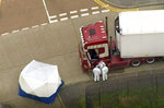 An aerial view as police forensic officers attend the scene after a truck was found to contain a large number of dead bodies, in Thurrock, South England, early Wednesday Oct. 23, 2019. Police in southeastern England said that 39 people were found dead Wednesday inside a truck container believed to have come from Bulgaria. (UK Pool via AP)