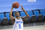 UCLA guard Chris Smith goes up for a basket during the second half of an NCAA college basketball game against California, Sunday, Dec. 6, 2020, in Los Angeles. (AP Photo/Kyusung Gong)
