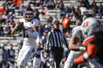 Texas A&M quarterback Kellen Mond (11) looks to pass against Auburn during the first half of an NCAA college football game on Saturday, Dec. 5, 2020, in Auburn, Ala. (AP Photo/Butch Dill)