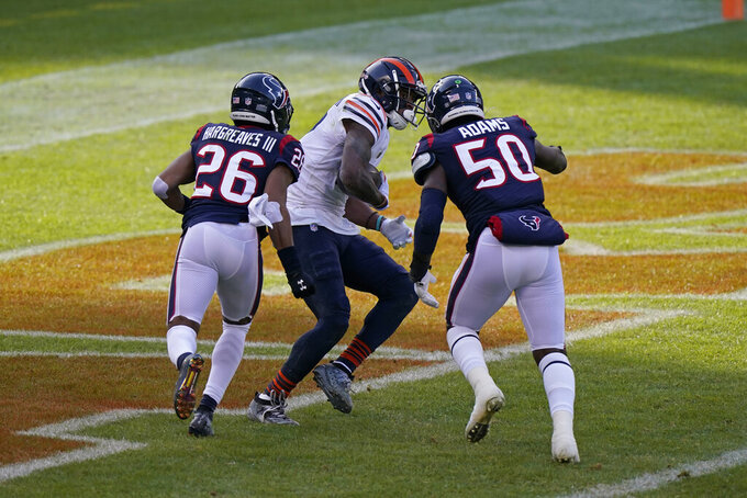 Chicago Bears' Allen Robinson (12) makes a touchdown reception against Houston Texans' Vernon Hargreaves III (26) and Tyrell Adams (50) during the first half of an NFL football game, Sunday, Dec. 13, 2020, in Chicago. (AP Photo/Nam Y. Huh)
